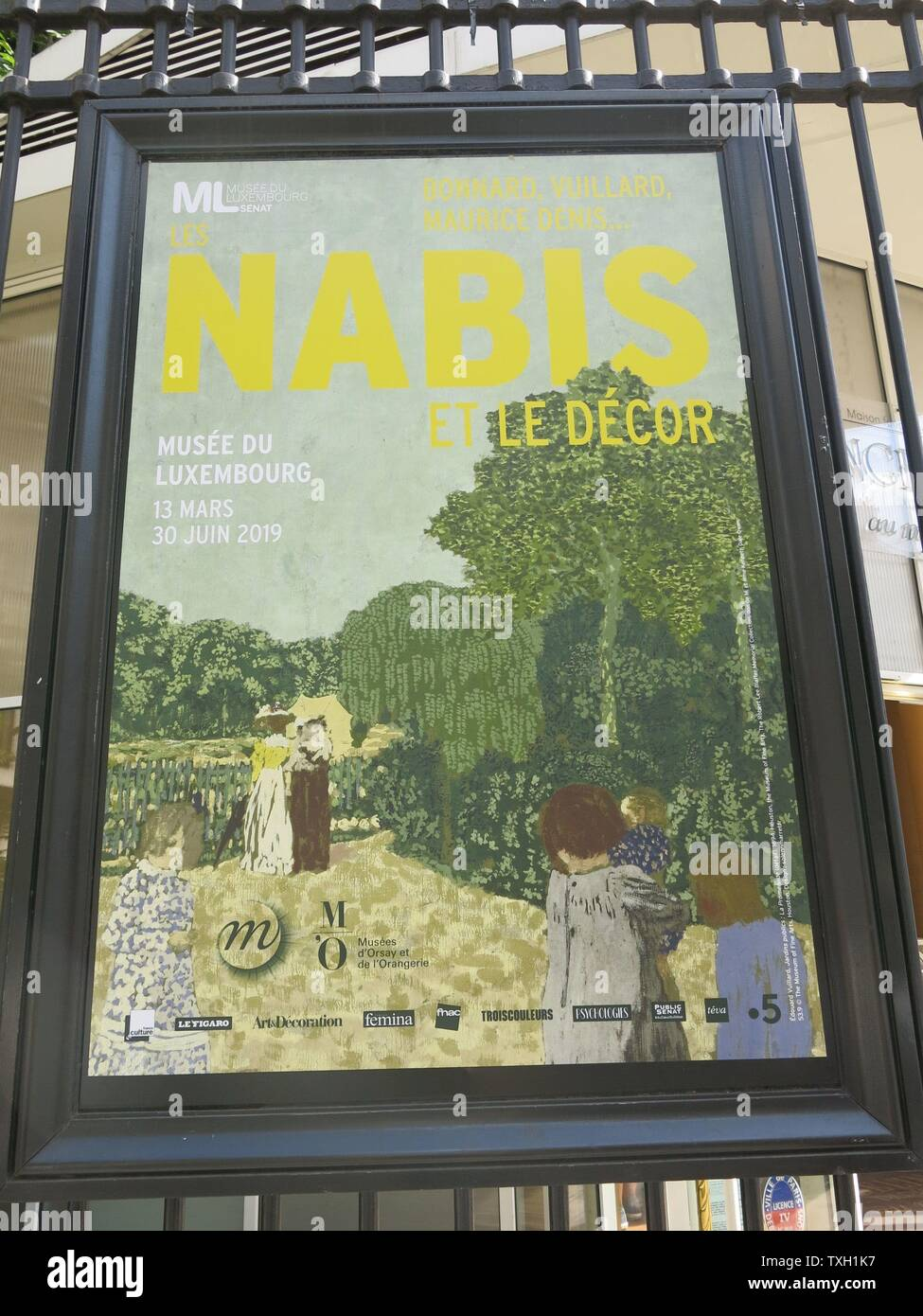 "The poster on the railings at the Luxembourg gardens advertising the art exhibition ""Les Nabis et le décor"" at the Musee du Luxembourg in Paris. Stock Photo"