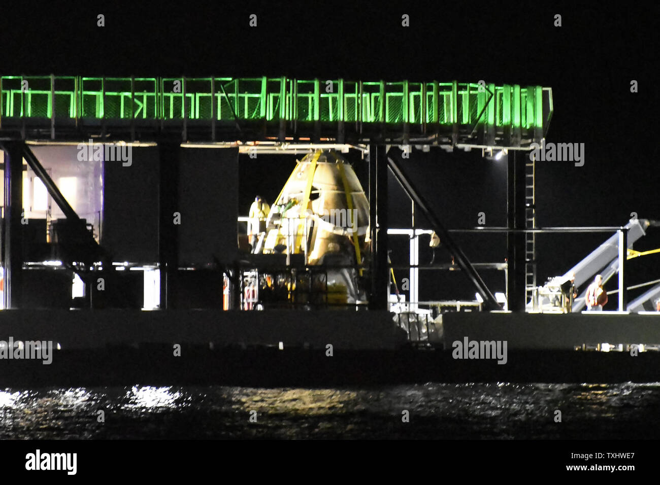 The SpaceX Crew Dragon spacecraft sits on the deck of the Company's
