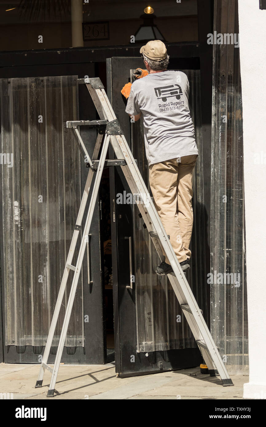 Workers attach hurricane shutters to a shop window on historic King Street shopping district in preparation for approaching Hurricane Florence September 11, 2018 in Charleston, South Carolina. Florence, a category 4 storm, is expected to hit the coast between South and North Carolina and could be the strongest storm on record for the East Coast of the United States. Photo by Richard Ellis/UPI Stock Photo