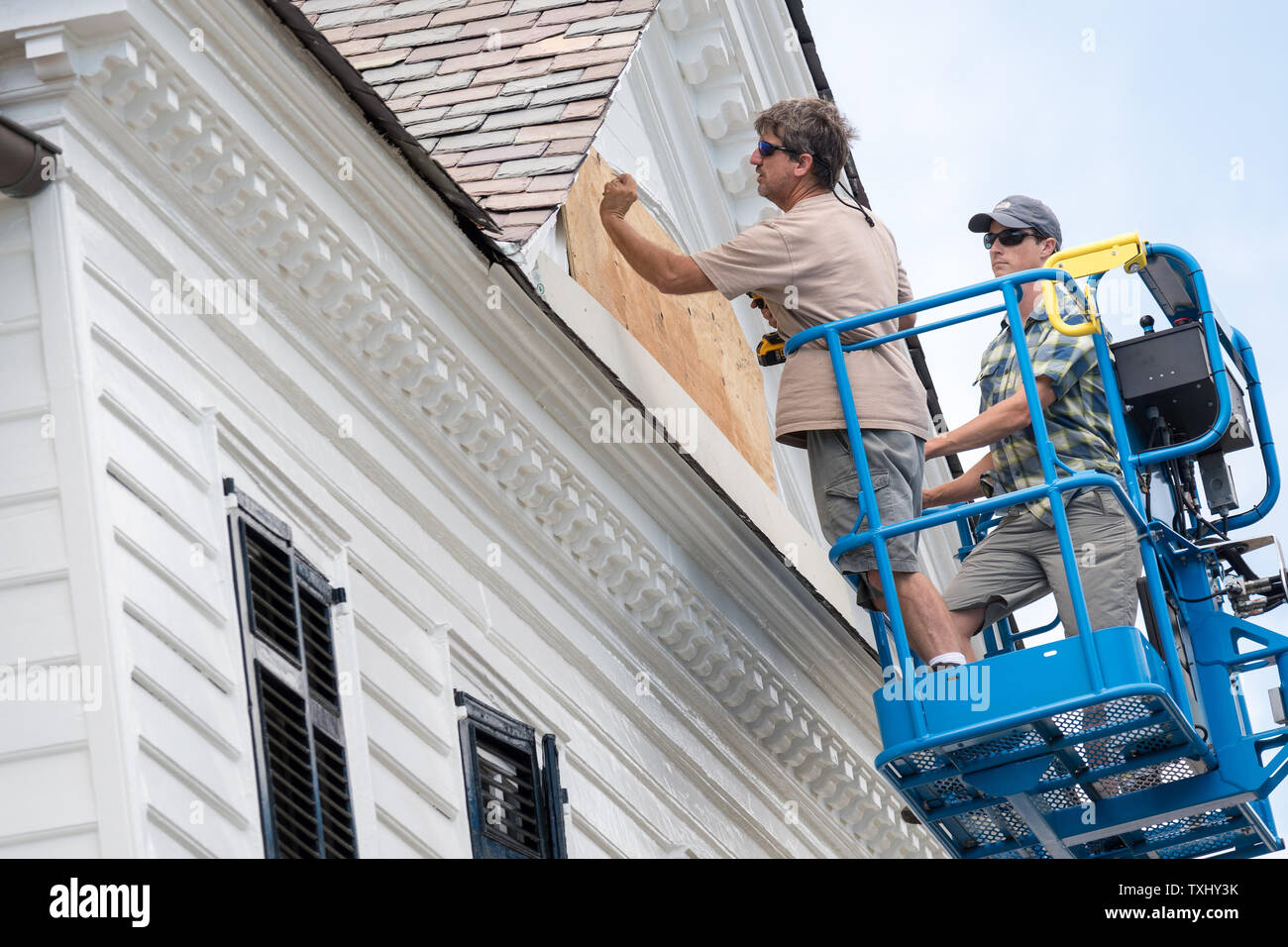Workers attach hurricane shutters to a historic home along the Charleston Battery in preparation for approaching Hurricane Florence September 11, 2018 in Charleston, South Carolina. Florence, a category 4 storm, is expected to hit the coast between South and North Carolina and could be the strongest storm on record for the East Coast of the United States. Photo by Richard Ellis/UPI Stock Photo