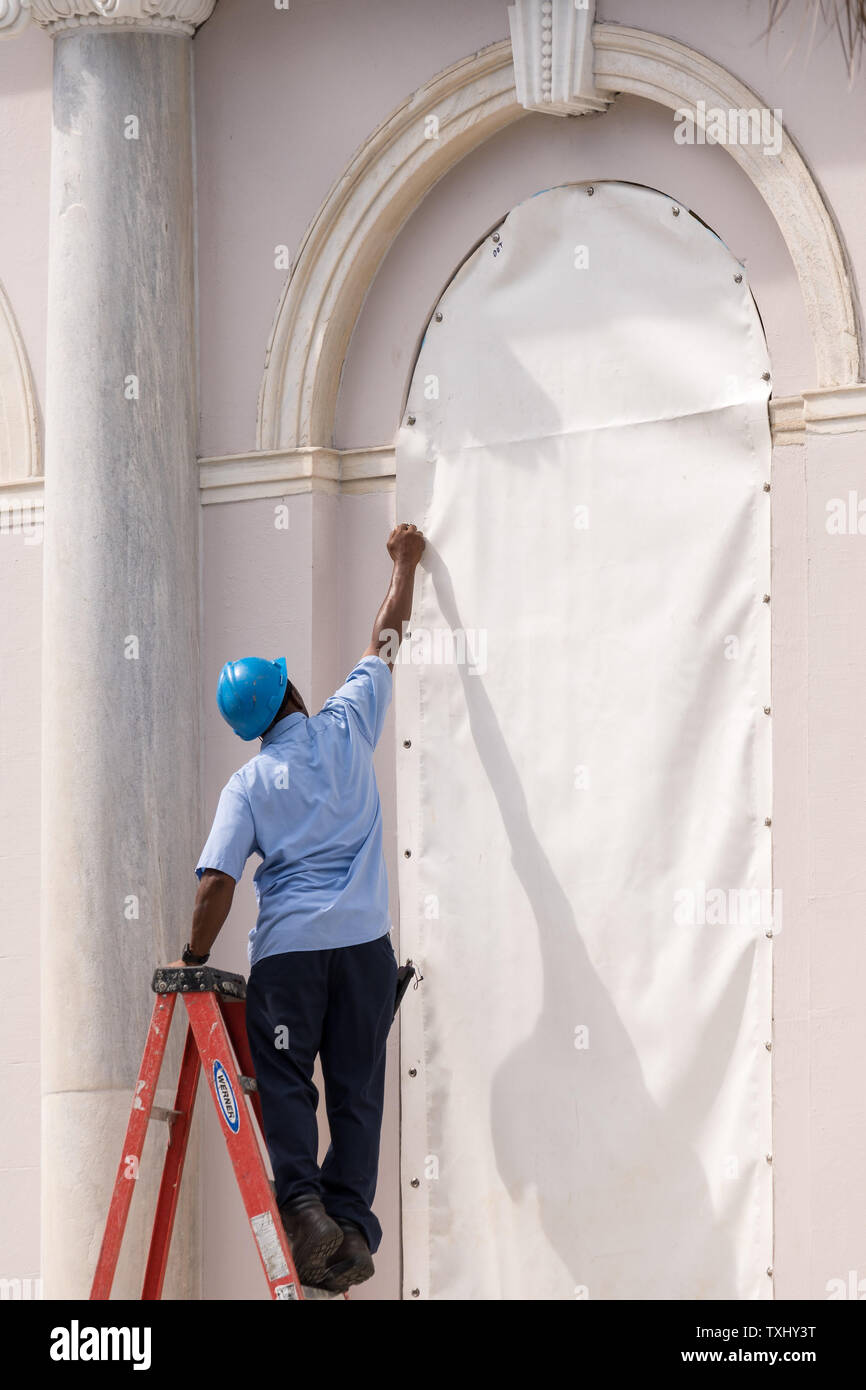 Workers attach hurricane cloth to windows on the Charleston City Hall in preparation for approaching Hurricane Florence September 11, 2018 in Charleston, South Carolina. Florence, a category 4 storm, is expected to hit the coast between South and North Carolina and could be the strongest storm on record for the East Coast of the United States. Photo by Richard Ellis/UPI Stock Photo