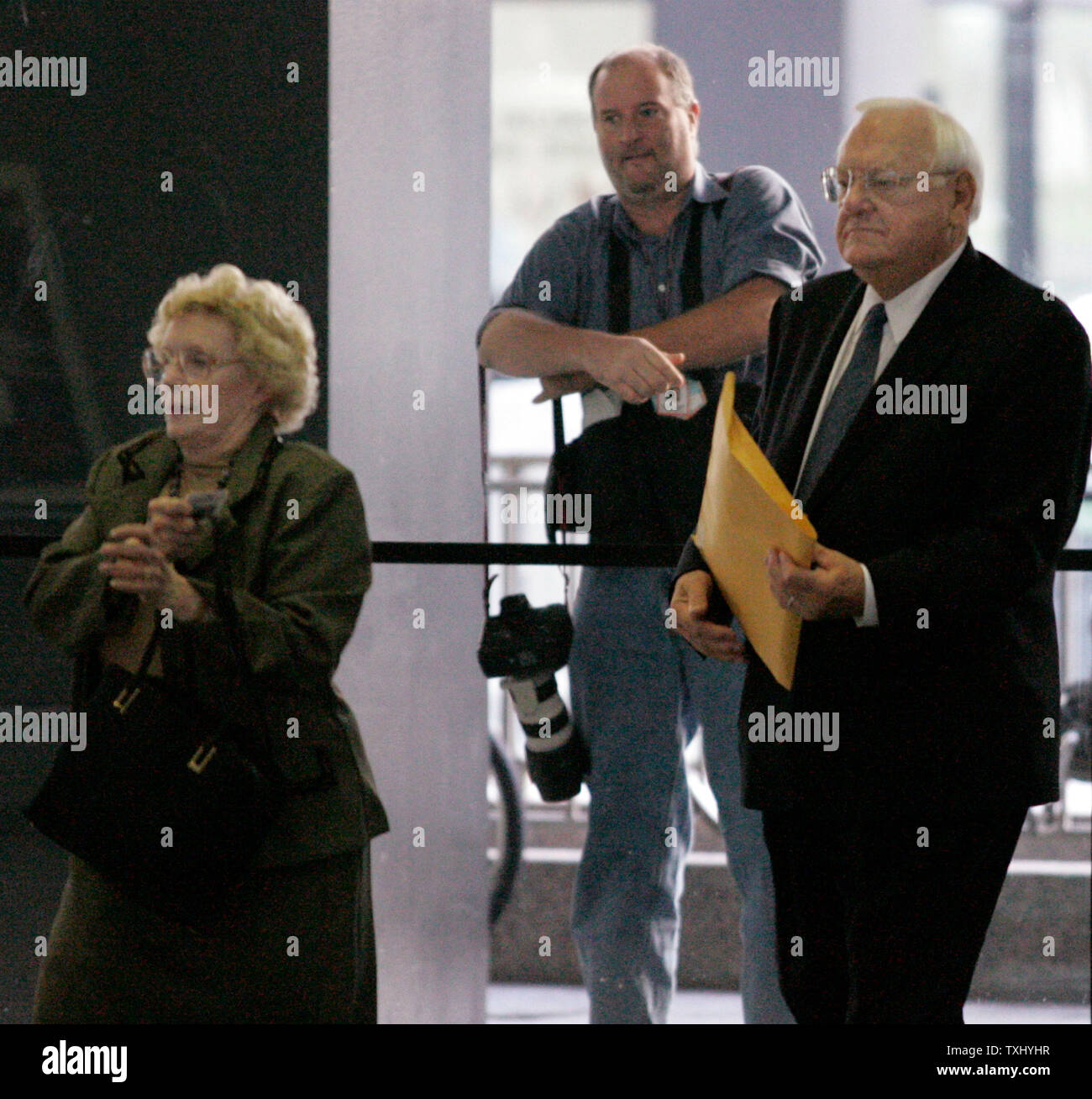 Former Illinois Gov  George Ryan, right, accompanied by his