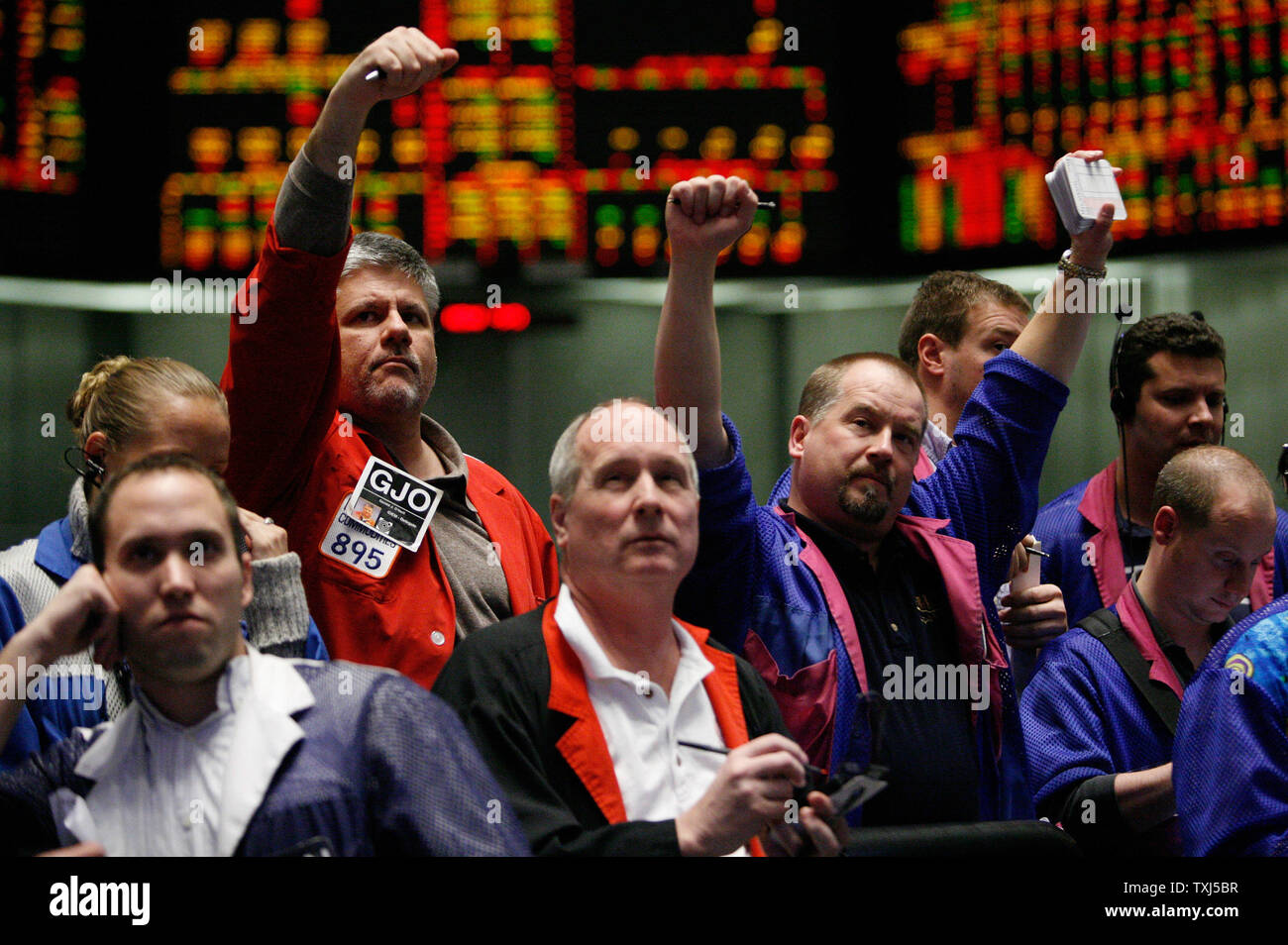 Traders Work In The Dow Jones Index Futures Pit At The Chicago