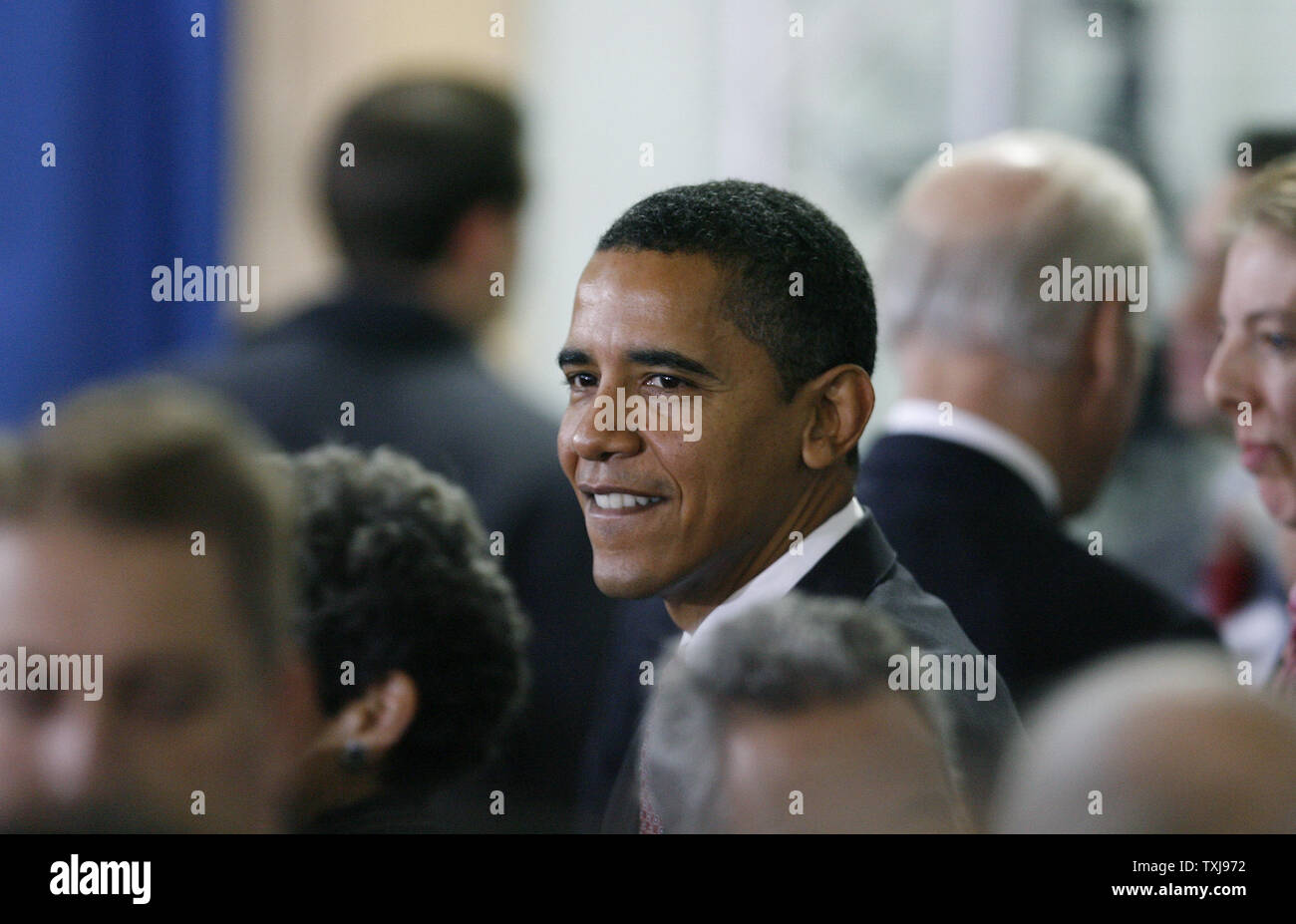 President-elect Barack Obama socializes after a news conference at Dodge Renaissance Academy on December 16, 2008 in Chicago.  Tuesday Obama appointed Arne Duncan, head of the Chicago Public Schools, to be his education secretary. (UPI Photo/Brian Kersey) - Stock Image