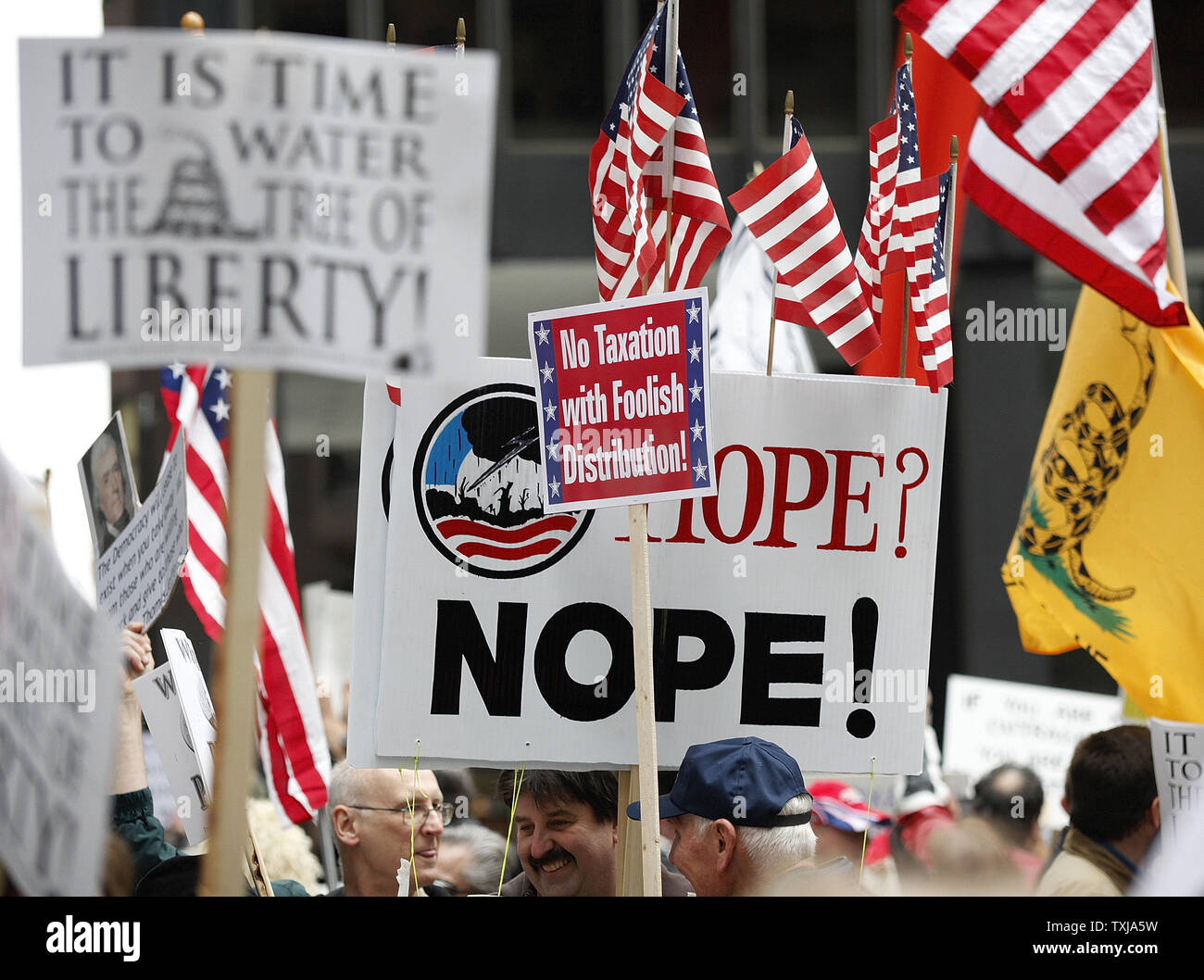Protesters hold up signs at a