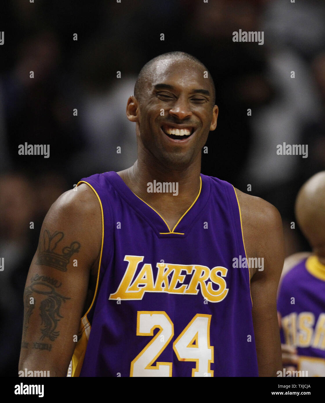 buy popular c6e39 fda01 Los Angeles Lakers guard Kobe Bryant smiles after defeating ...