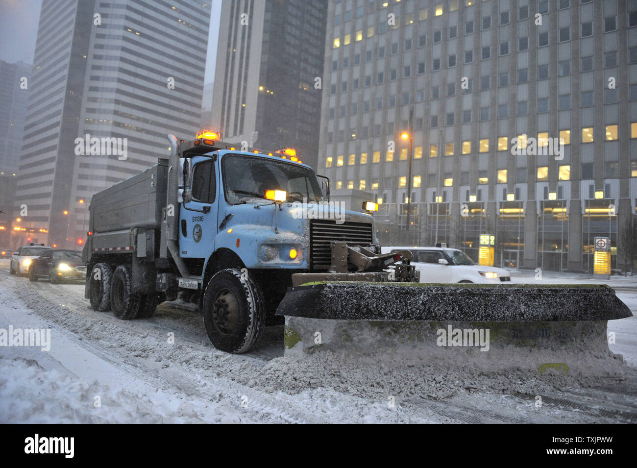 A city snow plow clears streets as a major snow storm hits on February 1, 2011 in Chicago. Up to two feet of snow is expected to fall in the Chicago area as a winter storm created blizzard conditions from the southern Great Plains to the upper midwest on Tuesday.     UPI/Brian Kersey - Stock Image
