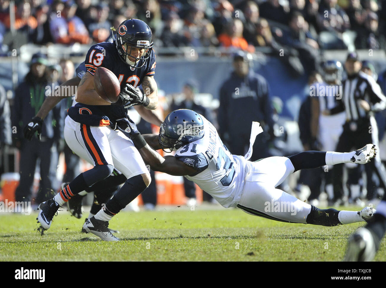 b65ebba27 Seattle Seahawks strong safety Kam Chancellor (R) strips the ball from  Chicago Bears wide