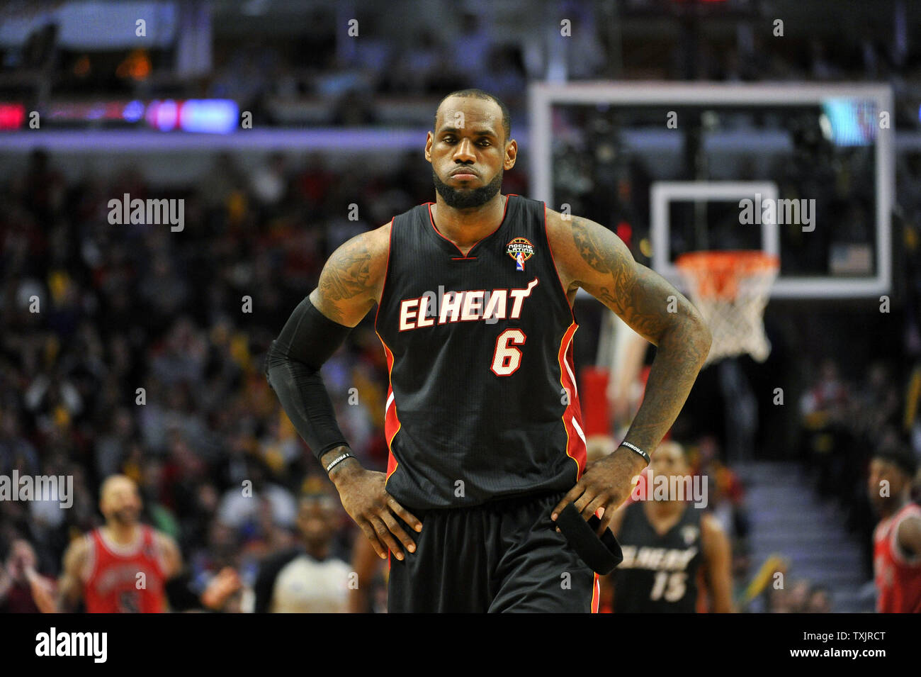 best sneakers 2ab6e 9c04d Miami Heat forward LeBron James stands on the court after he ...
