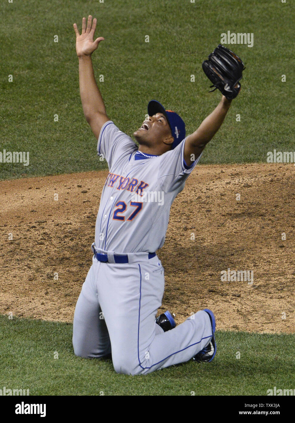New York Mets closer Jeurys Familia celebrates after striking out the final Chicago Cubs batter and completing the series sweep in game 4 of the National League Championship Series at Wrigley Field in Chicago on October 21, 2015. The Mets defeated the Cubs 8-3.     Photo by Jim Frischling/UPI - Stock Image