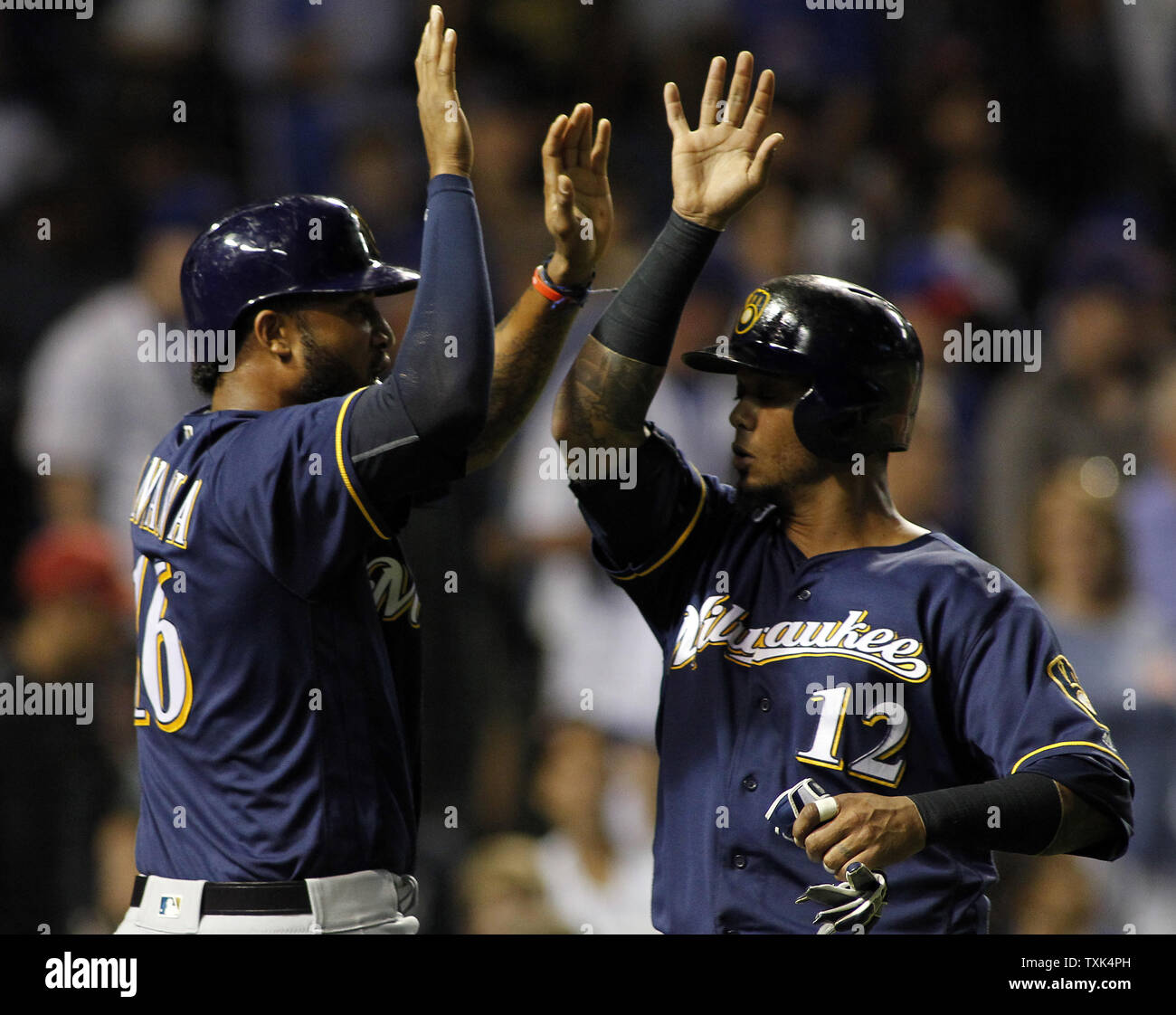 Milwaukee Brewers Domingo Santiago (L) and Martin Maldonado celebrate scoring in the eight inning of their game against the Chicago Cubs on September 15, 2016 in Chicago. The Brewers defeated the Cubs 5-4. Photo by Frank Polich/UPI - Stock Image