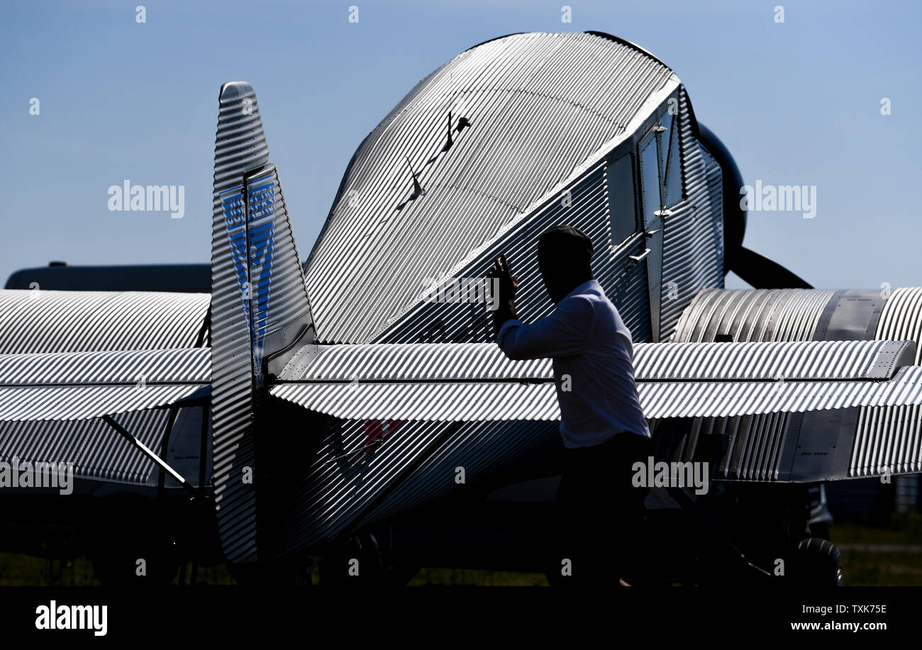 25 June 2019, Saxony-Anhalt, Dessau-Roßlau: A Junkers F 13 aircraft is standing at the airfield in Dessau. Exactly 100 years ago, an aircraft of this type took off for the first time in Dessau. The aircraft, designed by aircraft pioneer Hugo Junkers, was the world's first all-metal commercial aircraft and is regarded as a pioneer in civil aviation. Since 2016, the machine has again been manufactured in small series in Switzerland. Photo: Hendrik Schmidt/dpa-Zentralbild/dpa - Stock Image