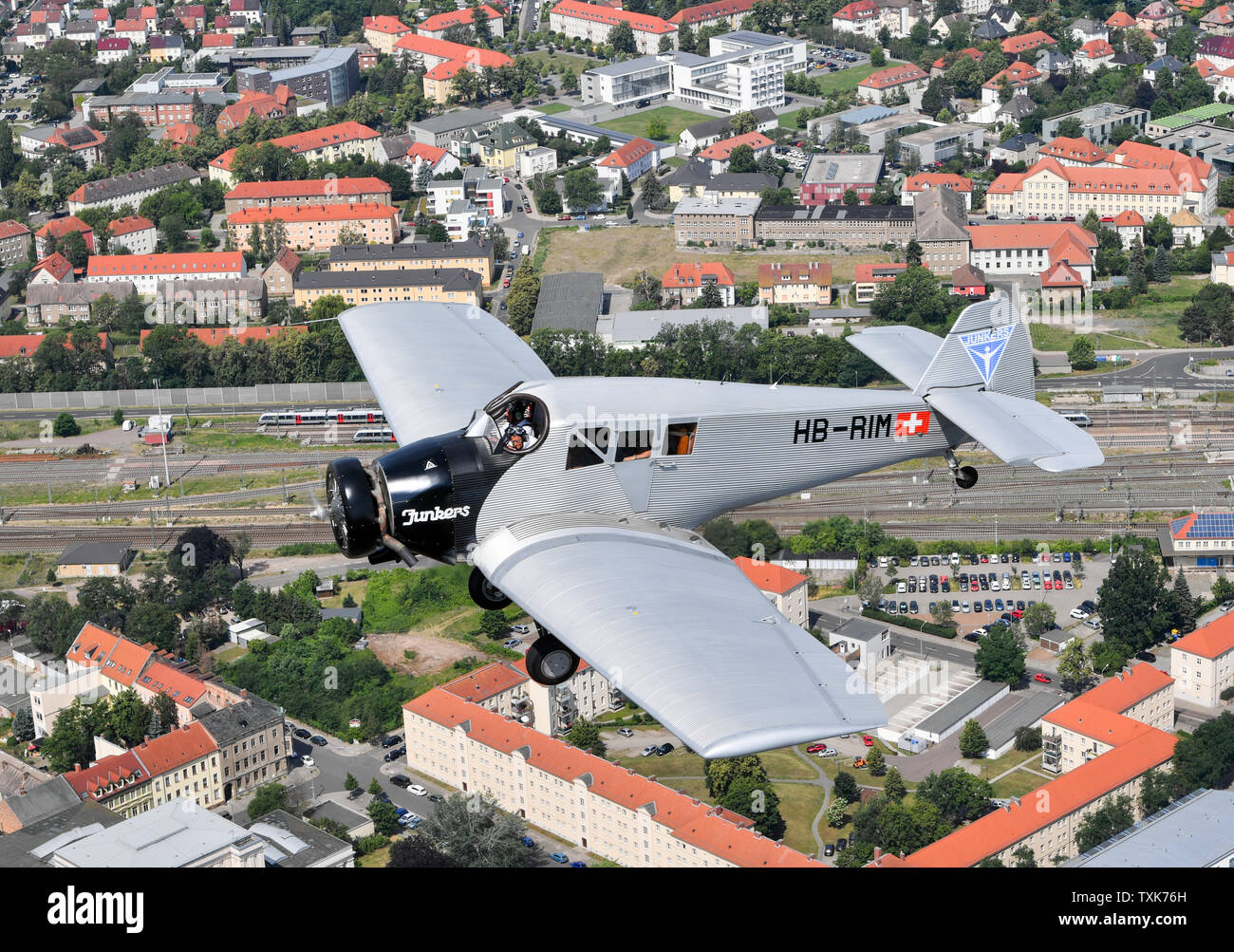 25 June 2019, Saxony-Anhalt, Dessau-Roßlau: The pilots Dieter Morszeck and Kurt Waldmeier steer the Junkers F 13 via Dessau. Exactly 100 years ago, an aircraft of this type took off for the first time in Dessau. The aircraft, designed by aircraft pioneer Hugo Junkers, was the world's first all-metal commercial aircraft and is regarded as a pioneer in civil aviation. Since 2016, the machine has again been manufactured in small series in Switzerland. Photo: Hendrik Schmidt/dpa-Zentralbild/dpa - Stock Image