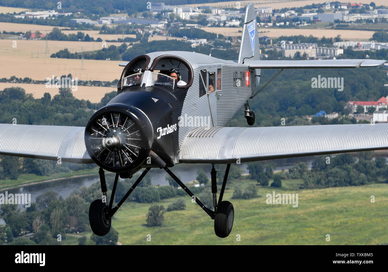 25 June 2019, Saxony-Anhalt, Dessau-Roßlau: The pilots Dieter Morszeck and Kurt Waldmeier steer the Junkers F 13 via Dessau. Exactly 100 years ago, an aircraft of this type took off for the first time in Dessau. The aircraft, designed by aircraft pioneer Hugo Junkers, was the world's first all-metal commercial aircraft and is regarded as a pioneer in civil aviation. Since 2016, the machine has again been manufactured in small series in Switzerland. The 100th anniversary of the first flight will be celebrated in Dessau with an airport festival, which will also include demonstration flights. Pho - Stock Image