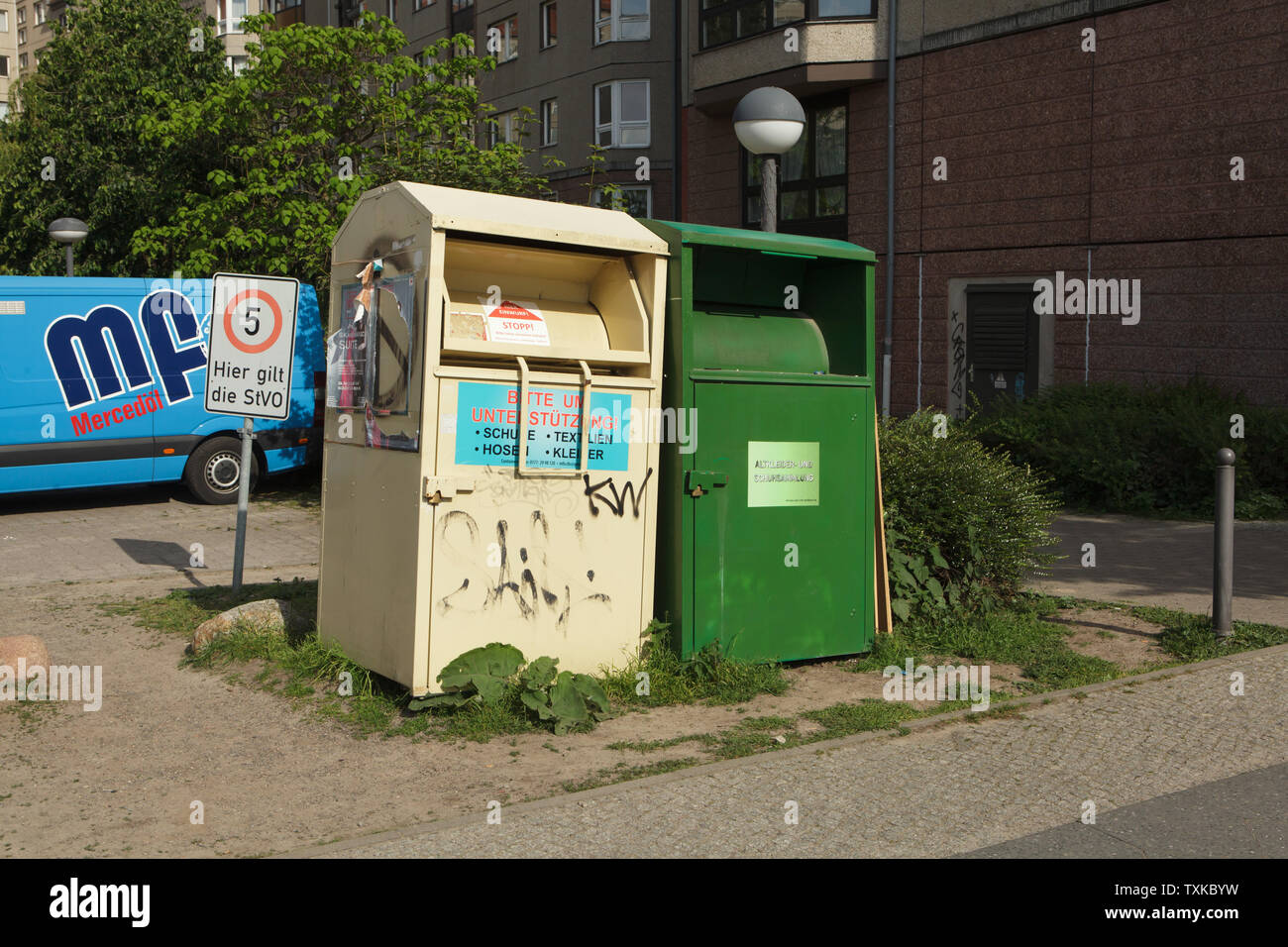 Two drop boxes for collection of used donated clothing and shoes approximately exactly on the place where Adolf Hitler committed suicide in the Führerbunker in the garden of the Reich Chancellery (Reichskanzlei), now in Gertrud-Kolmar-Straße in Berlin, Germany. Adolf Hitler and Eva Braun committed suicide in the Führerbunker on 30 April 1945. Stock Photo