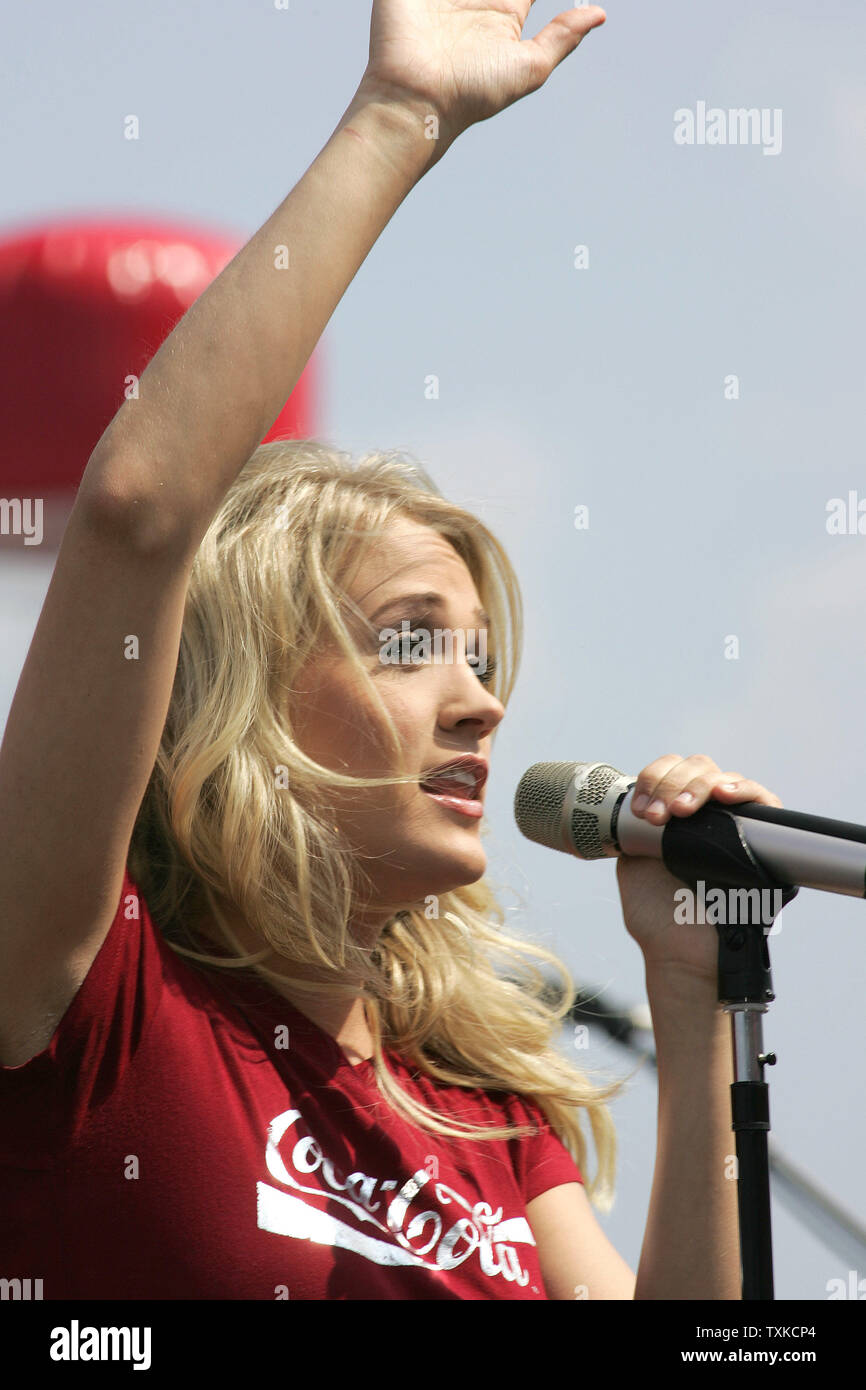 "American Country Music Award winner Carrie Underwood performs her pop hit, ""Jesus Take the Wheel"" prior to the NASCAR NEXTEL Coca-Cola 600 at Lowe's Motor Speedway in Charlotte, NC on May 28, 2006.  (UPI Photo/Bob Carey) Stock Photo"