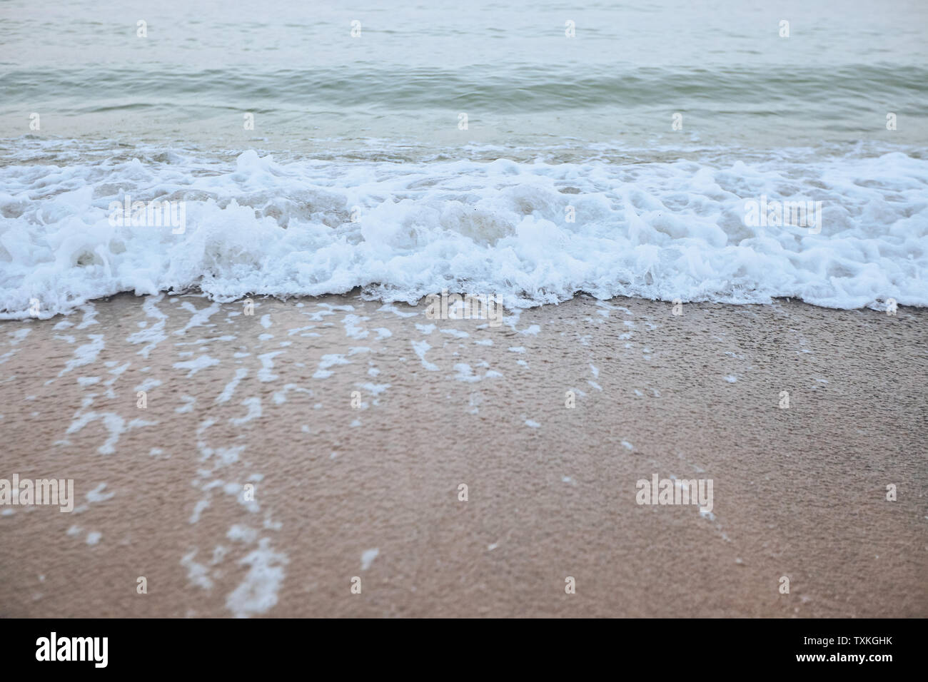 Fine beach and wawes under the summer sun - Stock Image