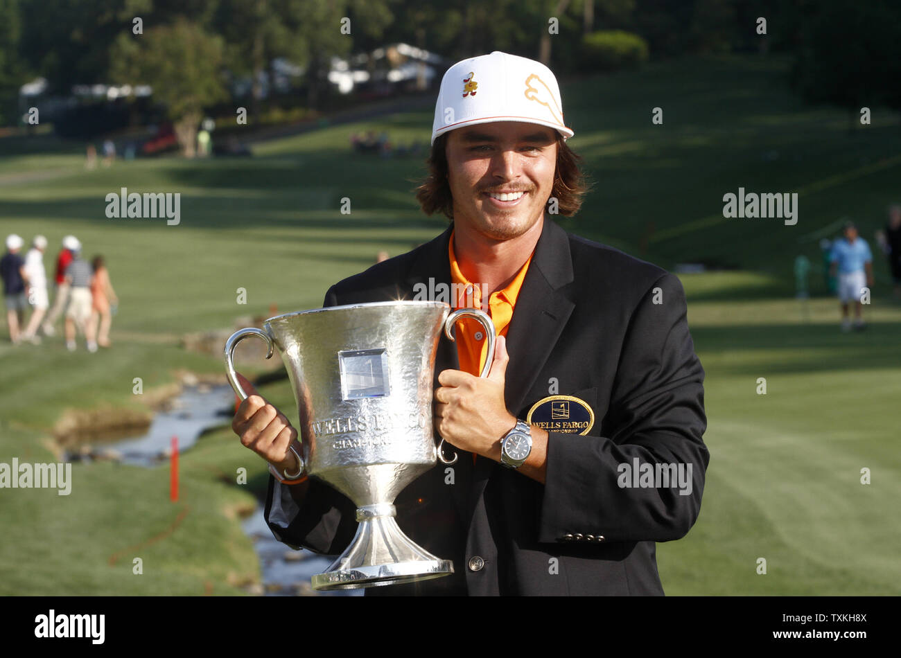 Ricky Fowler holds his trophy after winning the Wells Fargo Championship at Quail Hollow Club in Charlotte, North Carolina on May 6, 2012. Fowler earned his first PGA Tour win.  UPI/Nell Redmond - Stock Image