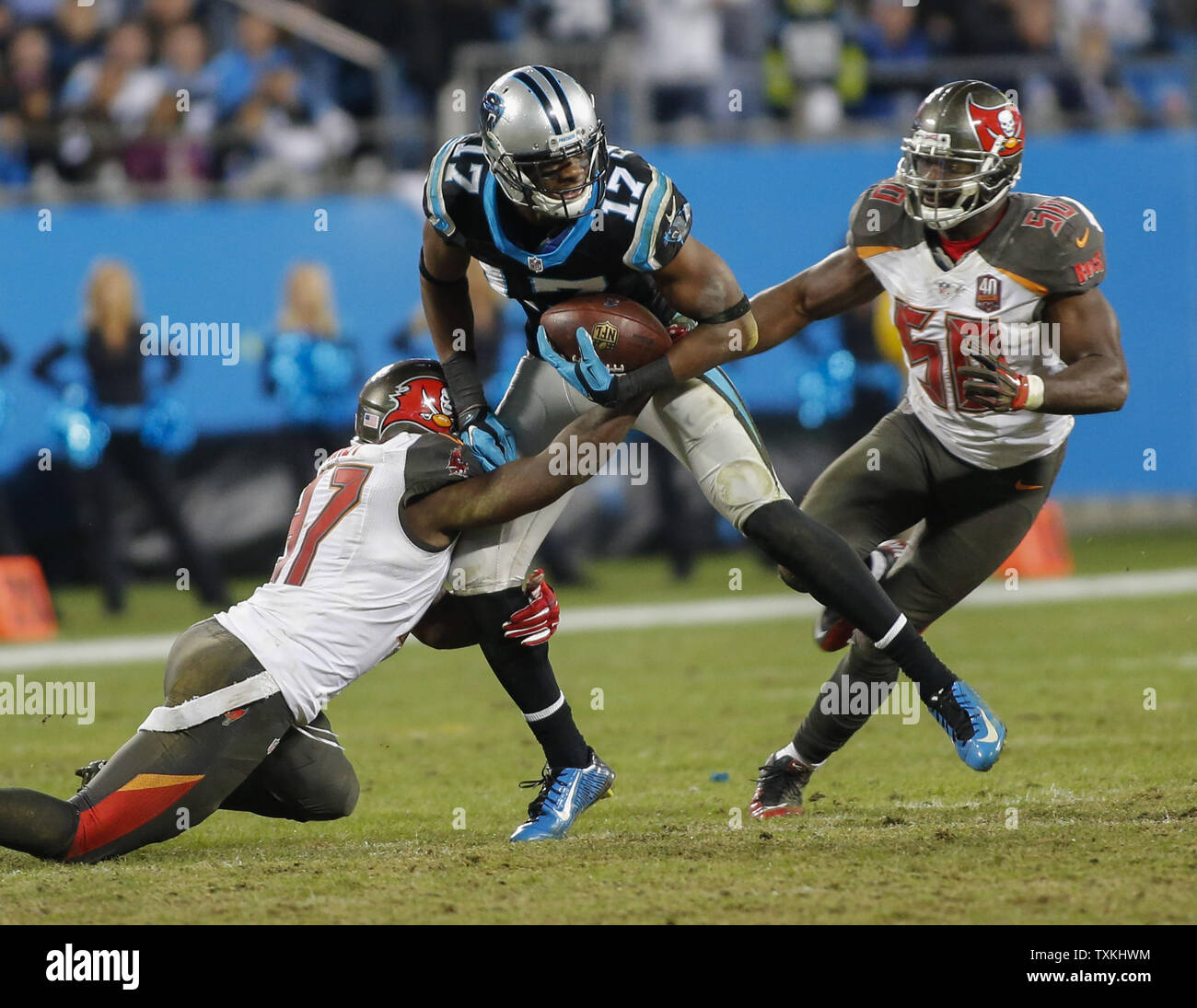 Carolina Panthers wide receiver Devin Funchess, center, runs after a catch for a first  down as Tampa Bay Buccaneers  defenders try to make a tackle in the second half of an NFL football game at Bank of America Stadium in Charlotte, North Carolina on January 3, 2016. Carolina won 38-10.   UPI/Nell Redmond . Stock Photo