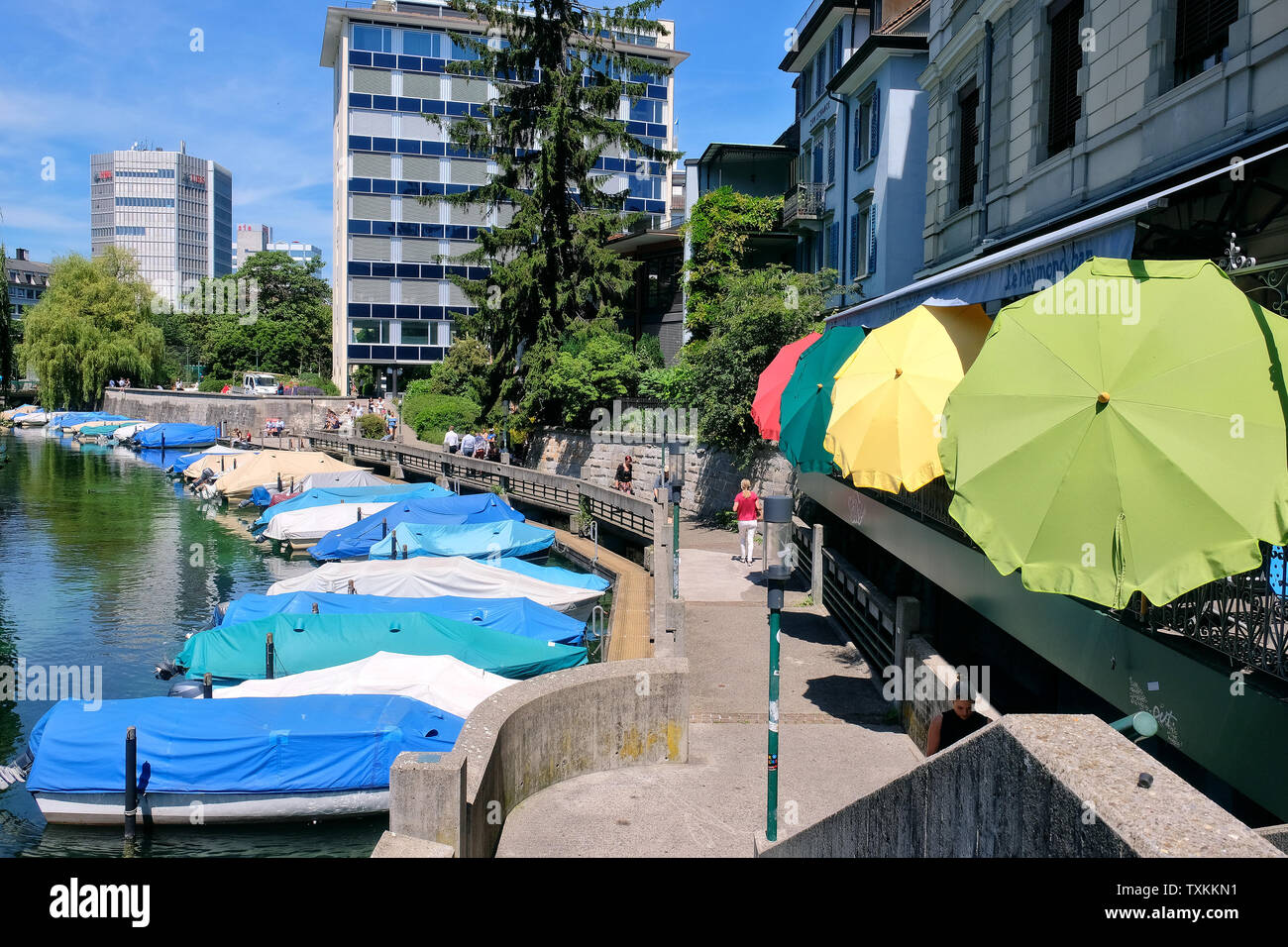 Schanzengraben promenade with covered boats and colourful parasols of Cafe Bar Le Raymond Bar, Zurich. Stock Photo