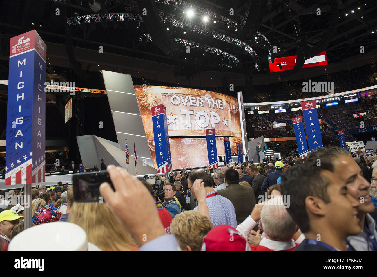 The main stage monitor flashes the news, Donald Trump wins the Republican Party nomination for president during the Republican National Convention at Quicken Loans Arena in Cleveland, Ohio on July 19, 2016.  Donald Trump will formally accept the Republican Party's nomination for President on Thursday night July 21st.  Photo by Molly Riley/UPI - Stock Image