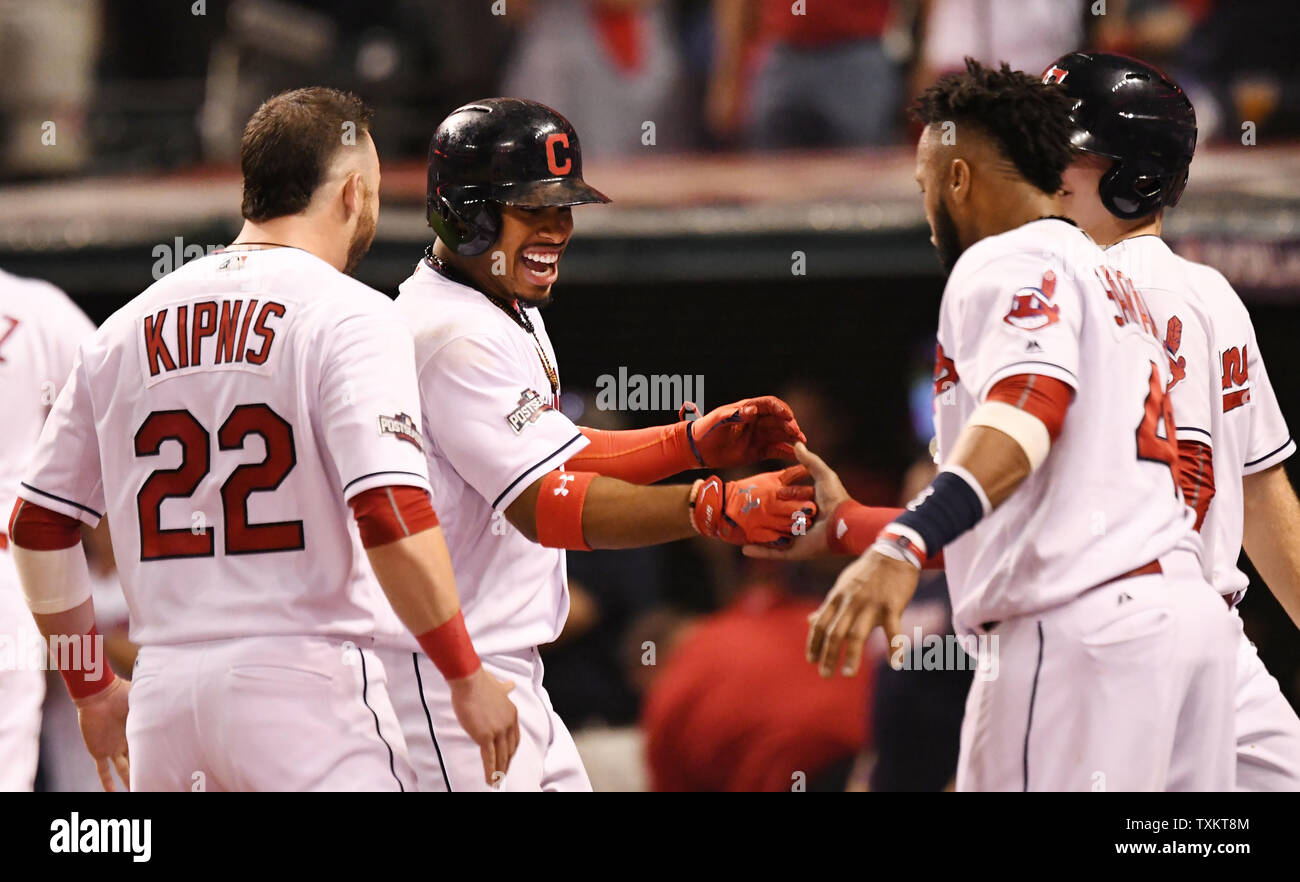 Cleveland Indians' Francisco Lindor is greeted by his teammates