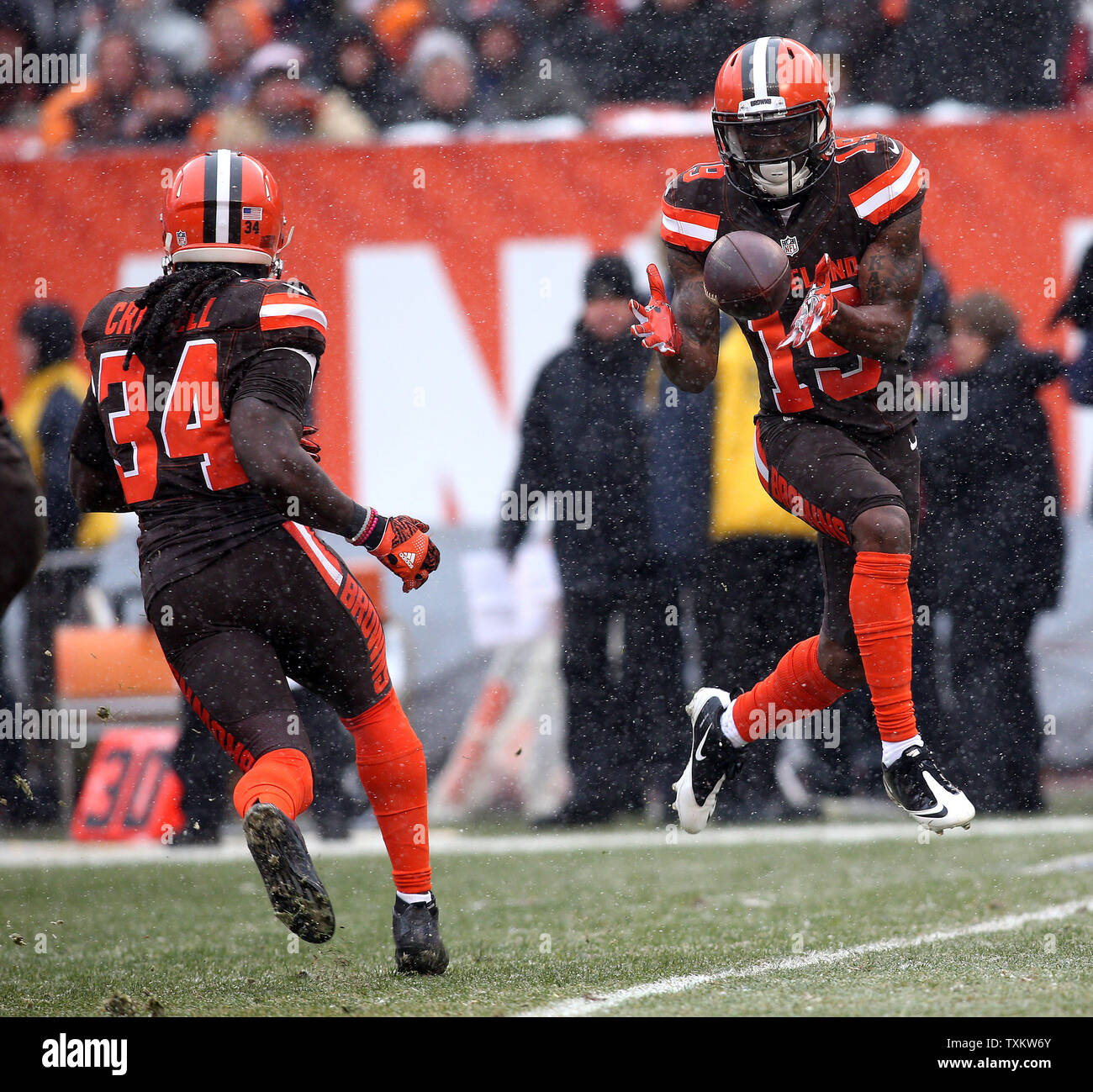 Cleveland Browns Corey Coleman takes a pitch on a reverse from Isiah Crowell during the first  quarter against the Cincinnati Bengals at FirstEnergy Stadium in Cleveland on December 11, 2016. Photo by Aaron Josefczyk/UPI Stock Photo