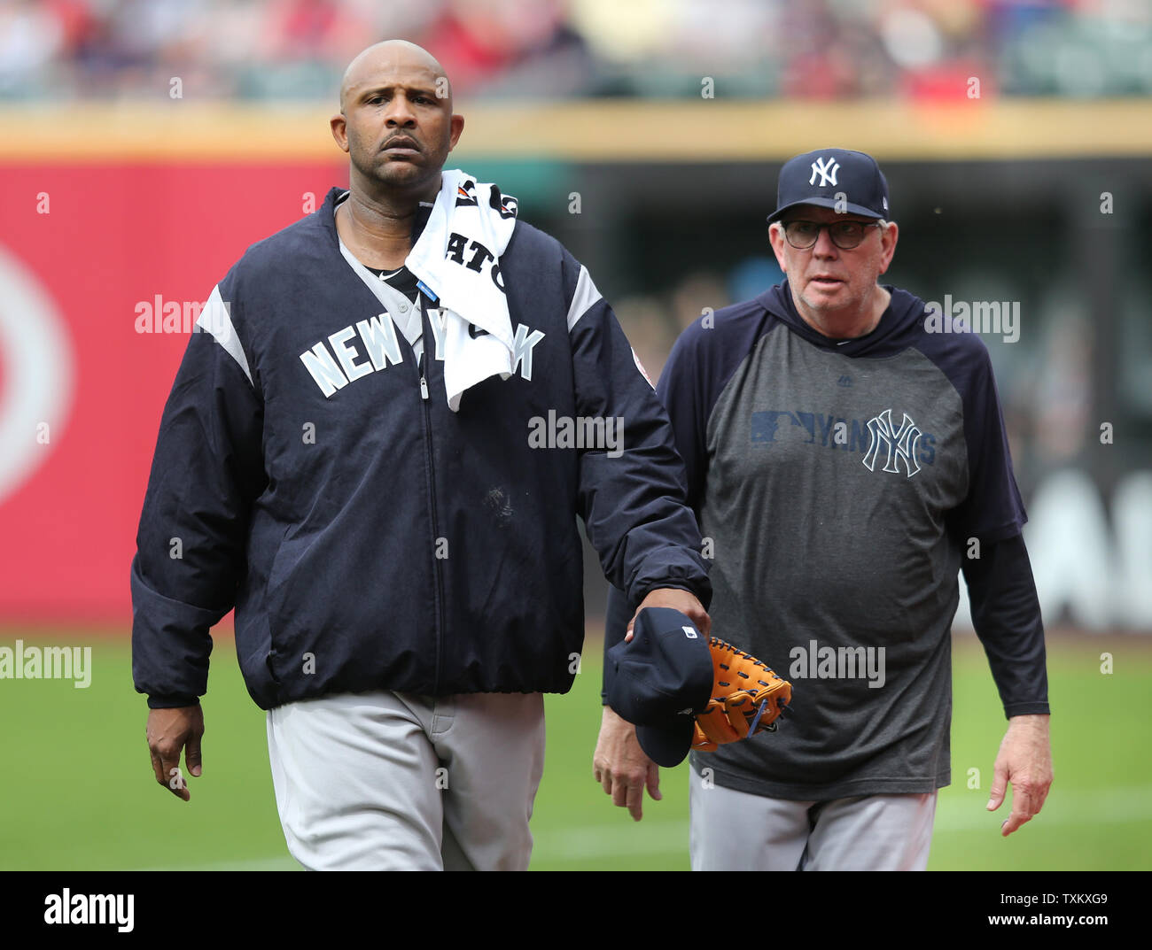 New York Yankees C C Sabathia walks to the dugout alongside pitching coach Larry Rothschild prior to his start against the Cleveland Indians in Cleveland OH June 8, 2019. Photo by Aaron Josefczyk/UPI - Stock Image
