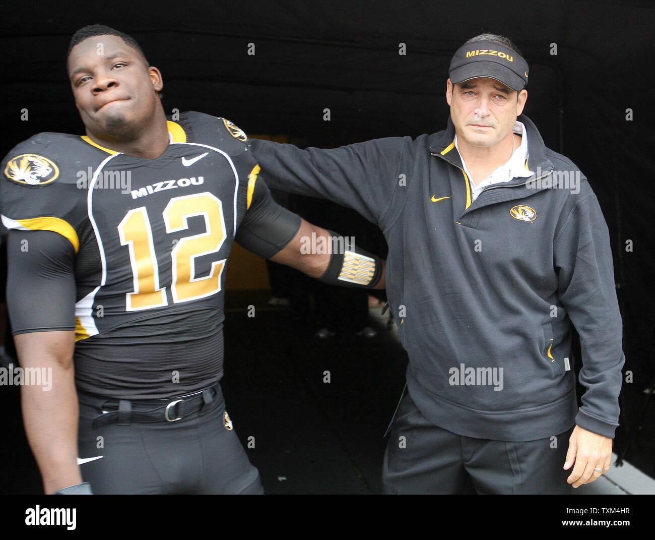 A tearful Missouri Tigers head football coach Gary Pinkel gives senior standout Sean Weatherspoon a hug as the two take the field for a game against the Iowa State Cyclones on Senior Day at Faurot Field in Columbia, Missouri on November 21, 2009. UPI/Bill Greenblatt - Stock Image