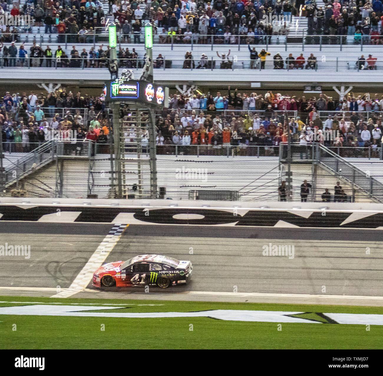 Kurt Busch Crosses The Finish Line To Win The 59th Daytona 500 On