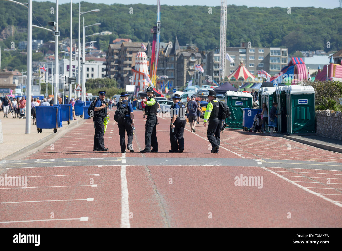 UK police team on duty at Weston-super-Mare's Air Festival event, June 2019. - Stock Image