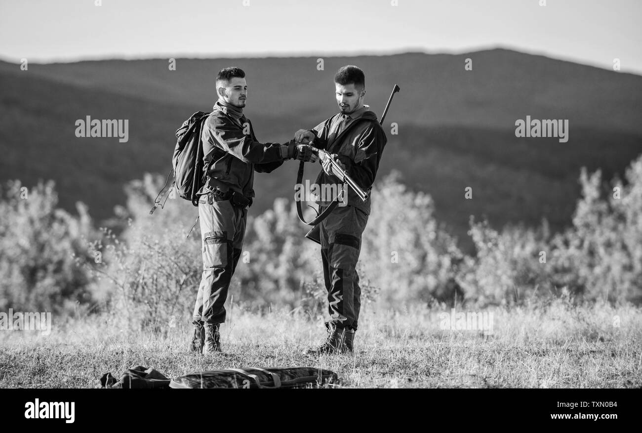 Men bearded hunters with rifle nature background. Experience and practice lends success hunting. How turn hunting into hobby. Guys hunting nature environment. Masculine hobby activity. Hunting season. - Stock Image
