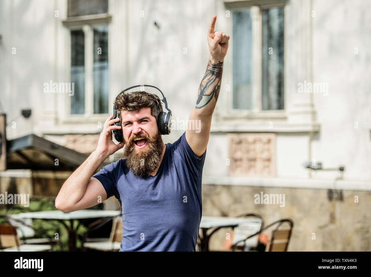 Stylish and handsome music lover. Mature hipster with beard. Man in headphones. Love this music. Good music increases my productivity. Enjoying music. Bearded man. brutal caucasian hipster. - Stock Image