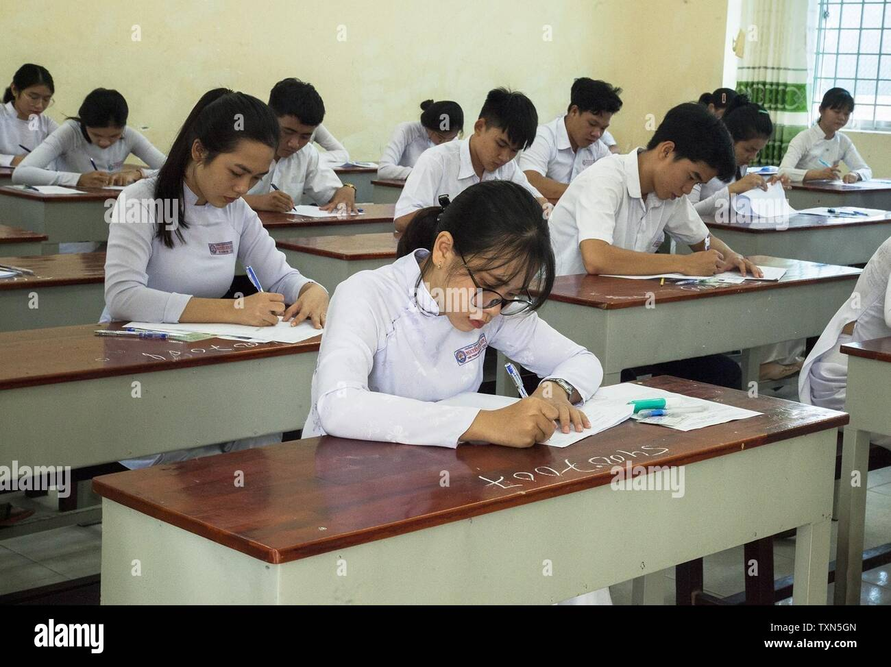 (190625) -- HANOI, June 25, 2019 (Xinhua) -- High school students take the national final exam at an examination location in Kien Giang province, Vietnam, June 25, 2019. Over 879,700 Vietnamese high school students on Tuesday started sitting for a national final exam, compared with nearly 925,800 students last year, local media reported. (Xinhua/VNA) - Stock Image