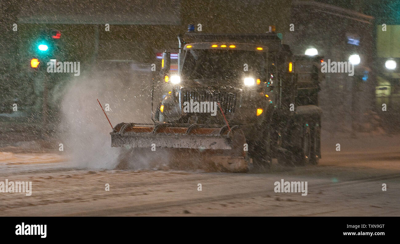 A Denver Department of Transportation snowplow vehicle makes another pass down a major residential road as the winter snowstorm continues to have snow fall on October 28, 2009 in Denver.      UPI/Gary C. Caskey - Stock Image