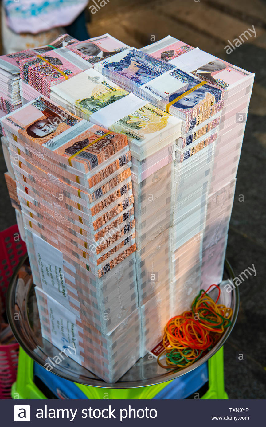 Stack of Cambodian money prepared for donation at buddhist temple, Phnom Penh, Cambodia - Stock Image