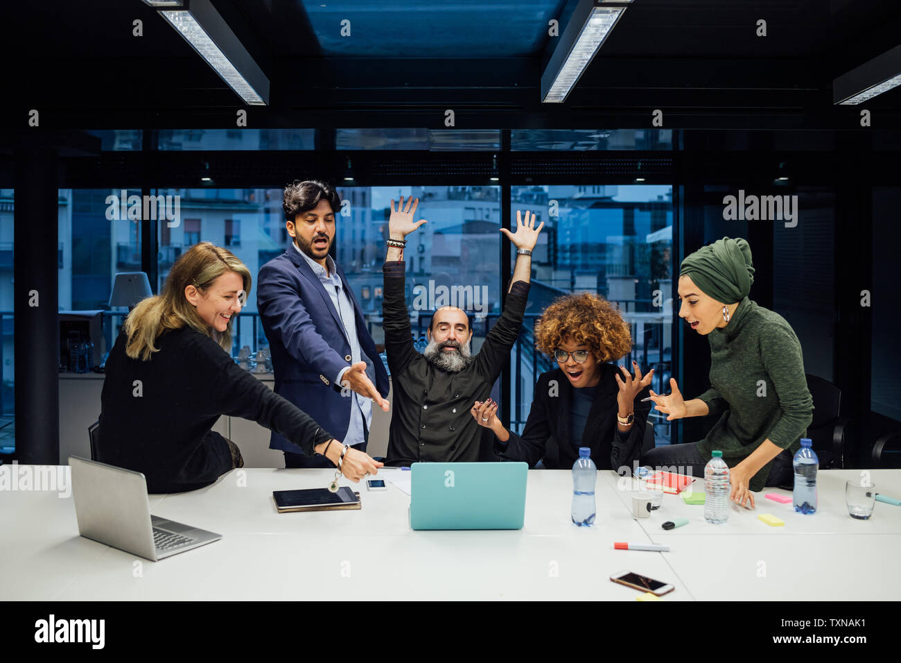 Business partners rejoicing in office - Stock Image