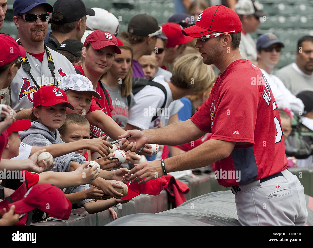 St. Louis Cardinals pitcher Adam Wainwright signs autographs for fans at Coors Field on July 8, 2010 in Denver.   Wainwright earned his very first All-Star team selection.                UPI/Gary C. Caskey - Stock Image