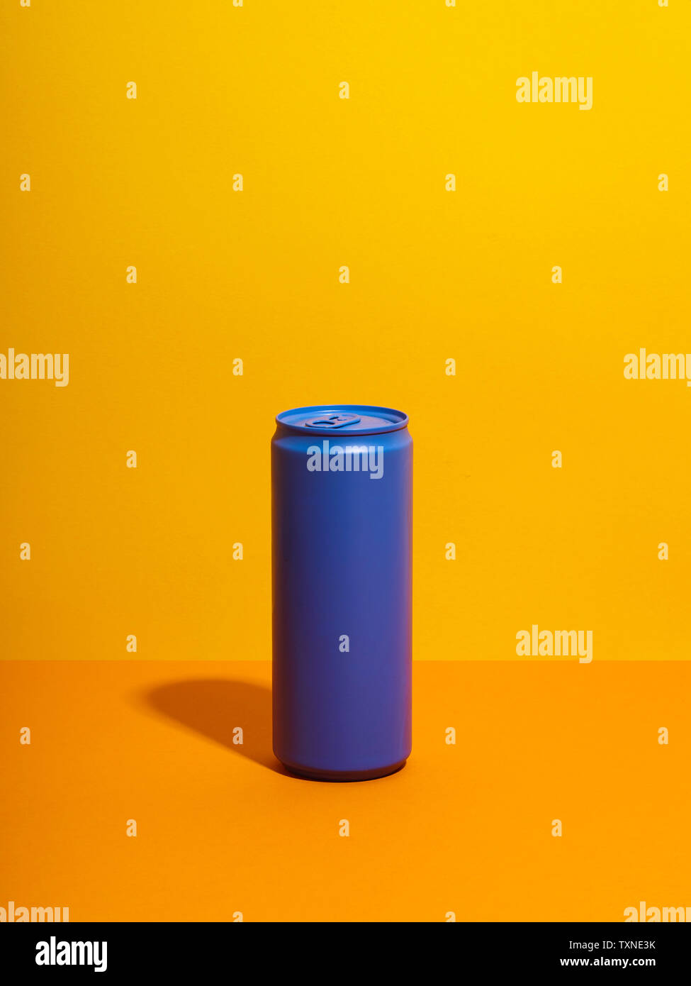 Still life with purple drink can and yellow background Stock Photo