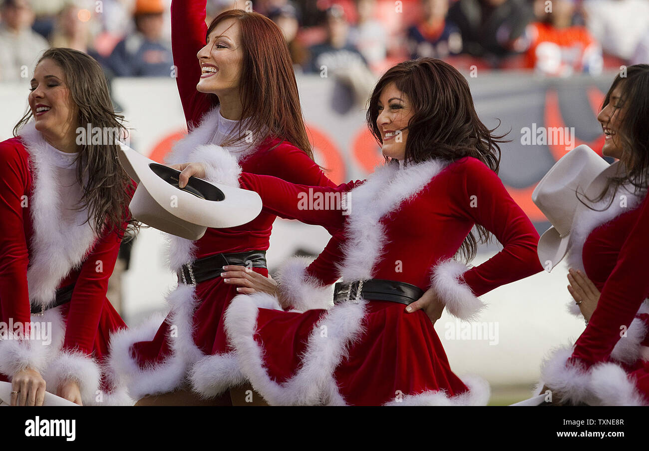 The Denver Broncos cheerleaders perform in their Santa Suits at Invesco Field at Mile High on December 26, 2010 in Denver.         UPI/Gary C. Caskey - Stock Image