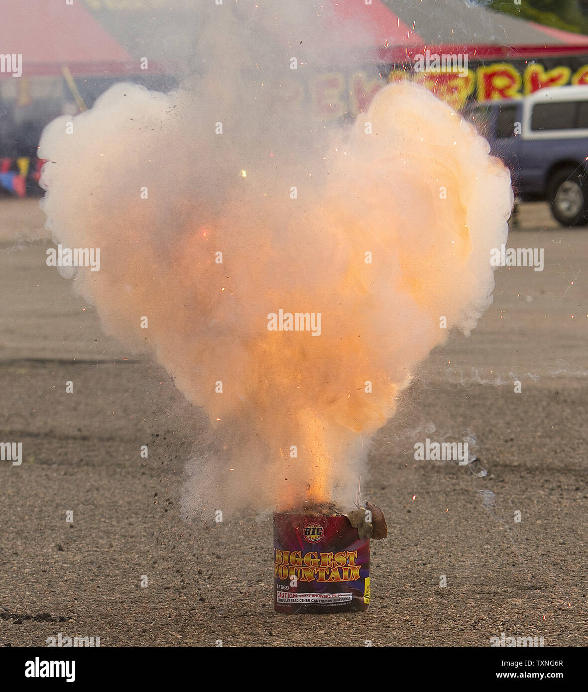 Fire erupts from fireworks barrell during a demonstration