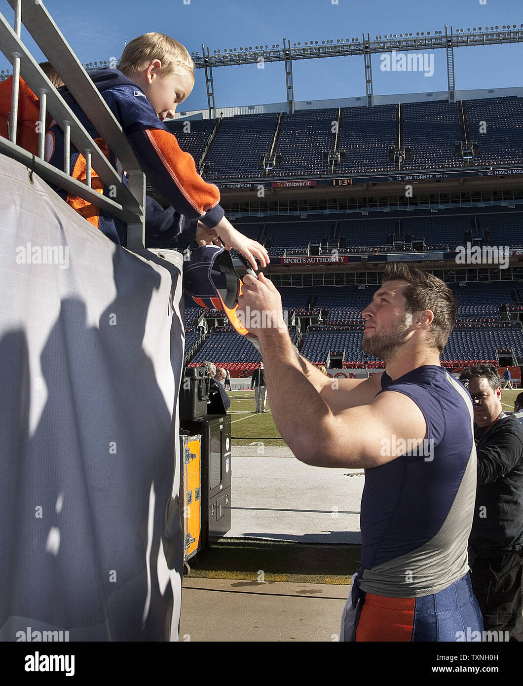 brand new c4173 760c7 A young Denver Broncos fan wearing a Tim Tebow jersey ...