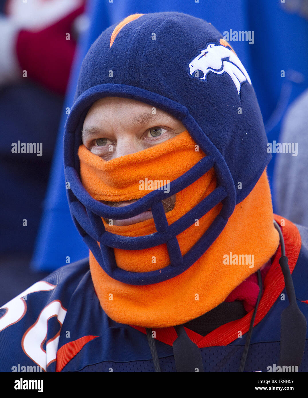 info for c6240 2289c A Denver Broncos fan wears head gear to ward off the cold ...