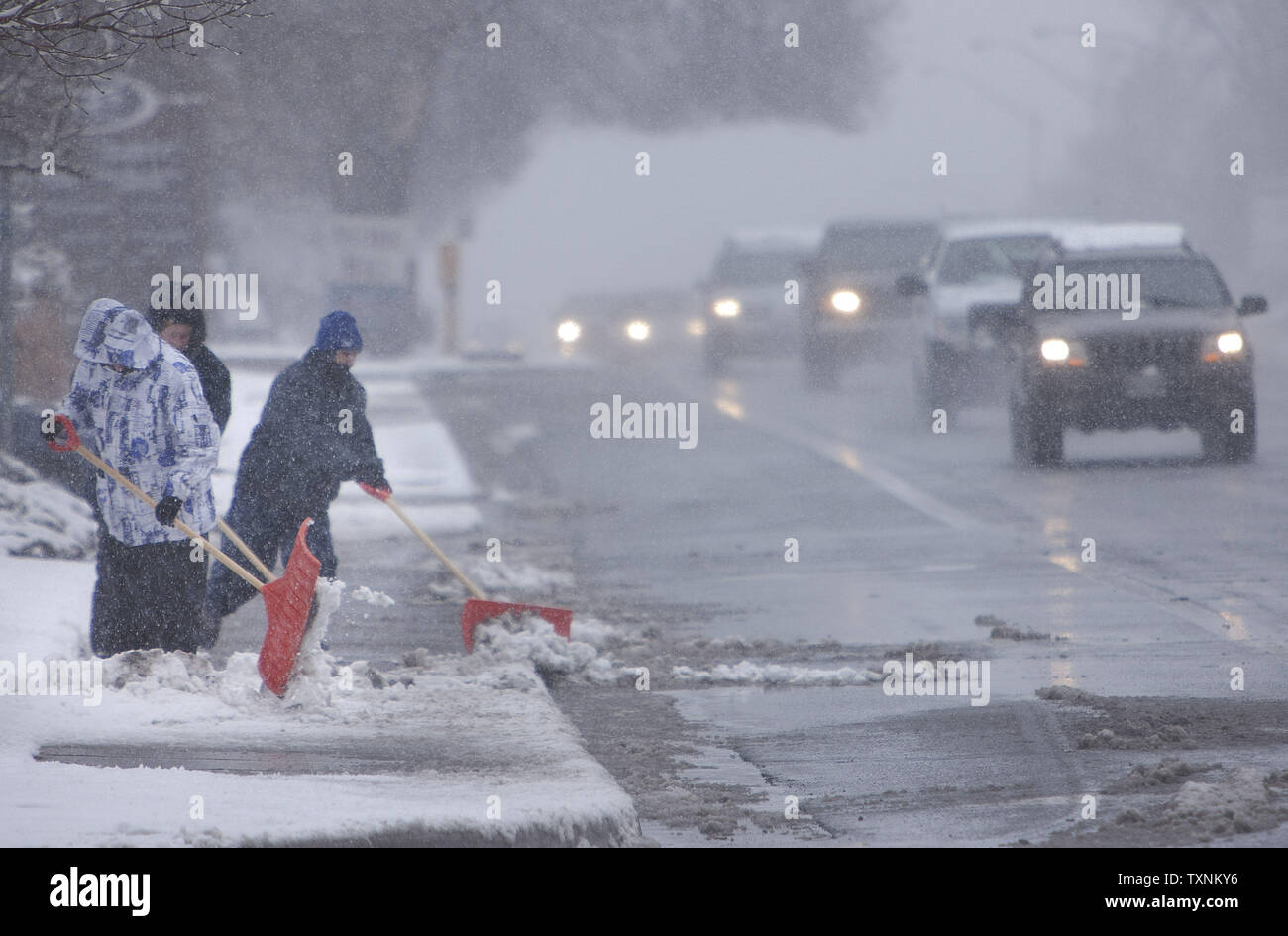 Drivers found streets wet and slushy during an all day winter storm in Denver on March 9, 2013.  Weather reports indicated 6-12 inches of snow shall fall in the area before the quick moving storm moves out into the eastern plains.     UPI/Gary C. Caskey - Stock Image