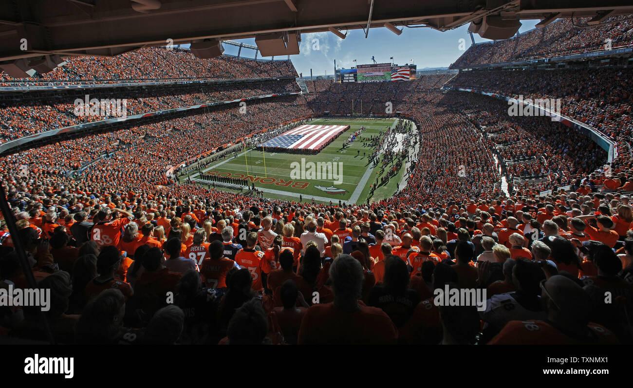 purchase cheap 7797a ba385 Denver Broncos fans wear orange saluting their team as they ...