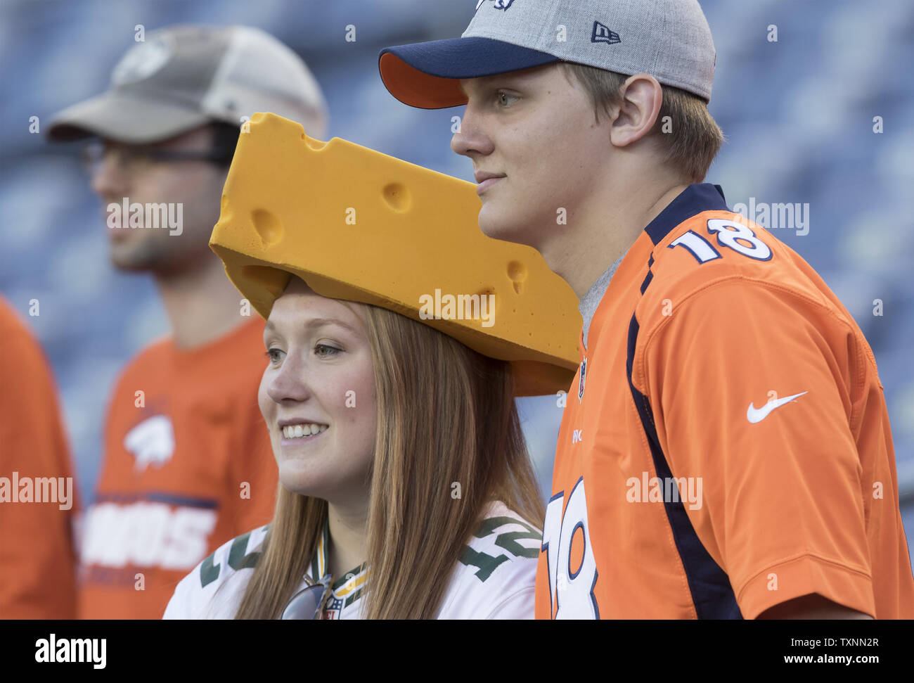 finest selection d45d9 c2dbc A Green Bay Packers fan wearing a cheesehead and a Aaron ...