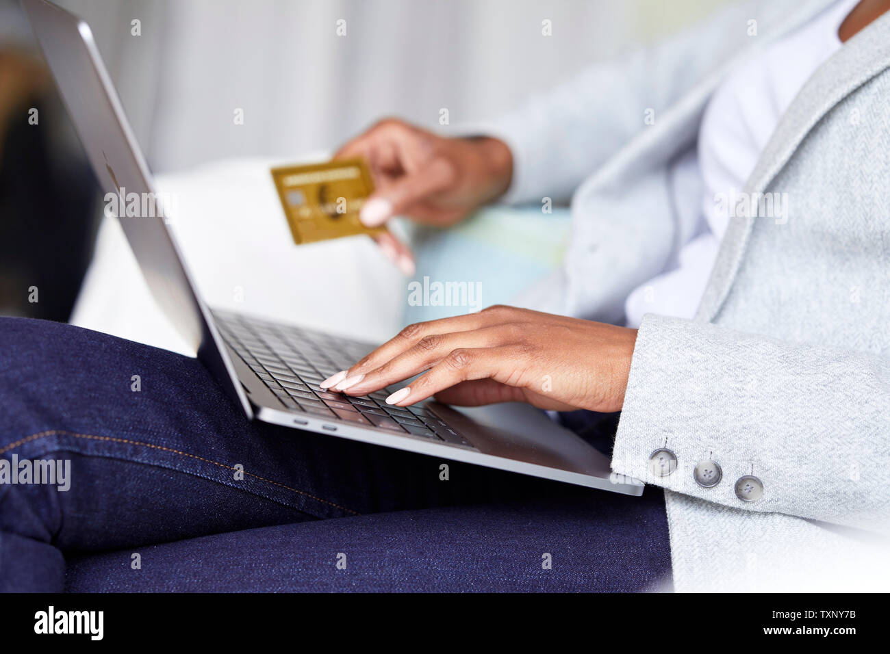 Ethnic woman shopping online using laptop Stock Photo