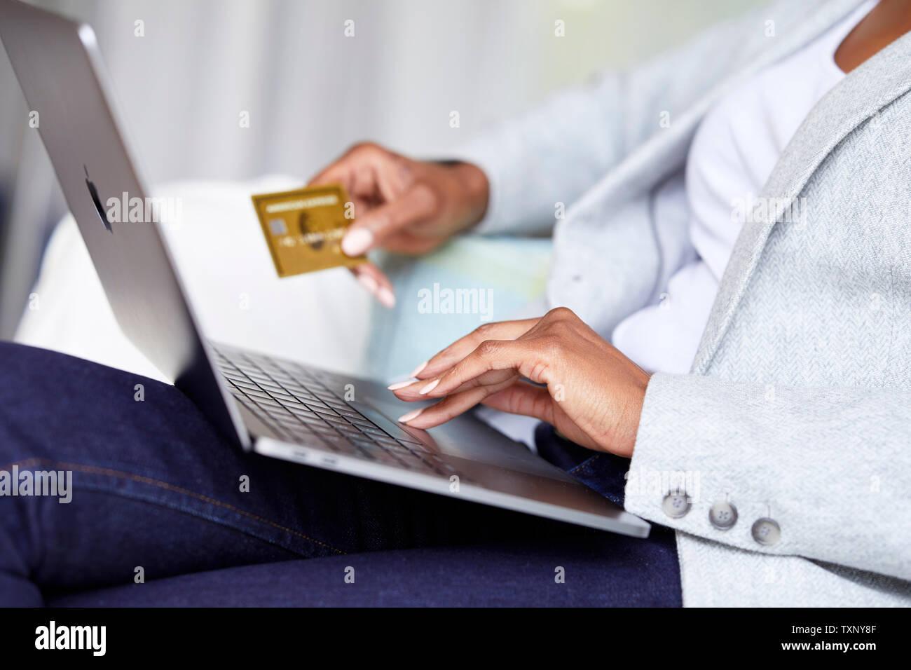 Ethnic woman shopping online using laptop Stock Photo