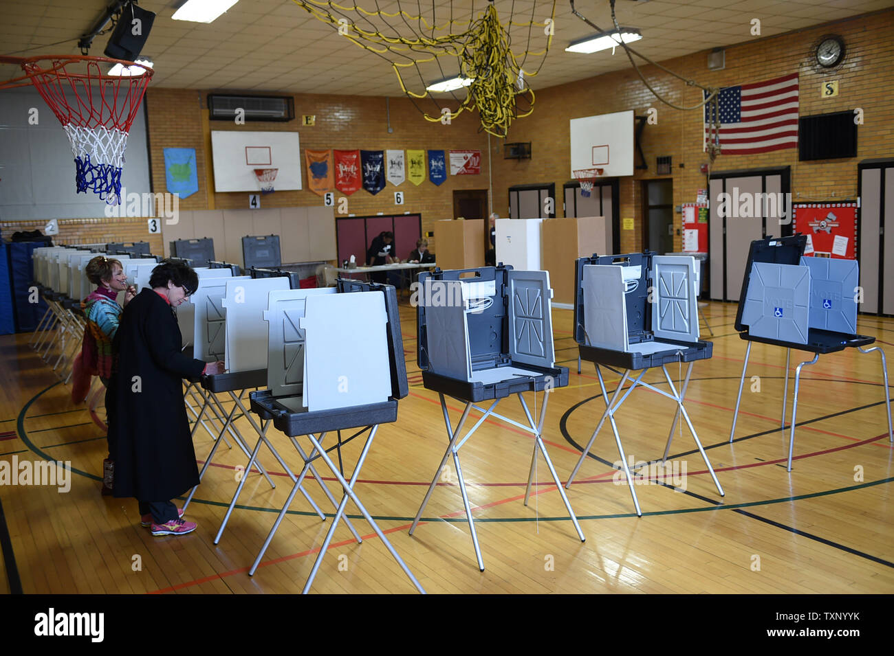 Residents vote in a polling place at Trombly Elementary School in Grosse Pointe, Michigan, March 8, 2016.  Michigan voters headed to the polls to vote in both the Republican and Democratic primaries Tuesday.     Photo by Molly Riley/UPI - Stock Image