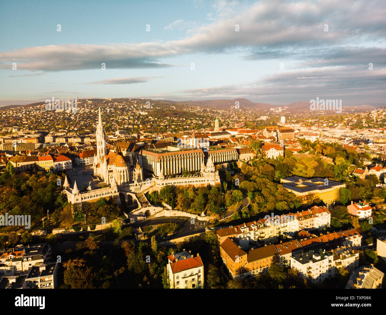 Aerial view of Fishermans Bastion and Matthias Church from above in Budapest during sunrise in autumn with dramatic sky (Budapest, Hungary, Europe) Stock Photo
